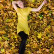 Royalty-Free Stock Photo: Beautiful woman - yellow autumn leaves
