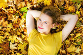Beautiful woman - yellow autumn leaves — Stock Photo