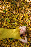 Beautiful woman with yellow leaves — Stock Photo