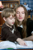 Mother and son reading book — Stock Photo