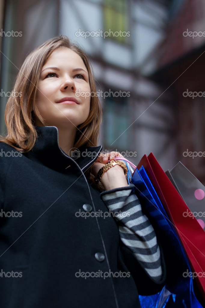 Beautiful young woman with shopping bags  Stock Photo #2387359