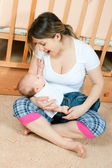 Mother and baby in living room — Stock Photo