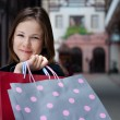 Young woman with shopping bags — Stock Photo #2486403