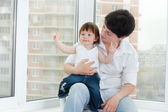 Mother and daughter near window — Stock Photo