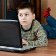 Boy playing computer game — Stock Photo #2568815