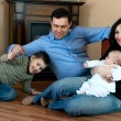 Happy family on th floor — Stock Photo #2574561
