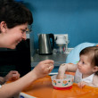 Mother and baby at the kitchen — Stock Photo #2589589