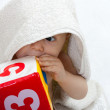 Baby portrait with towel — Stock Photo