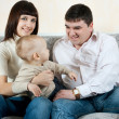 Happy family - father, mother and baby — Stock Photo