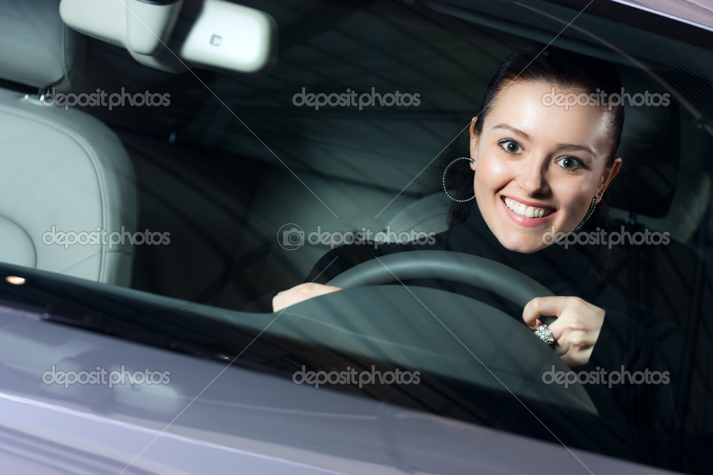 Young beautiful woman driving a car and smiling — Stock Photo #2634779