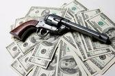 Moneu And Gun — Stock Photo