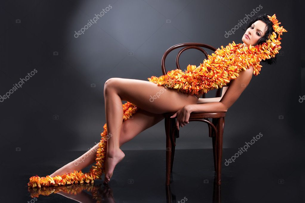Young beautiful nude woman with boa made of rose petals — Stock Photo #2391170