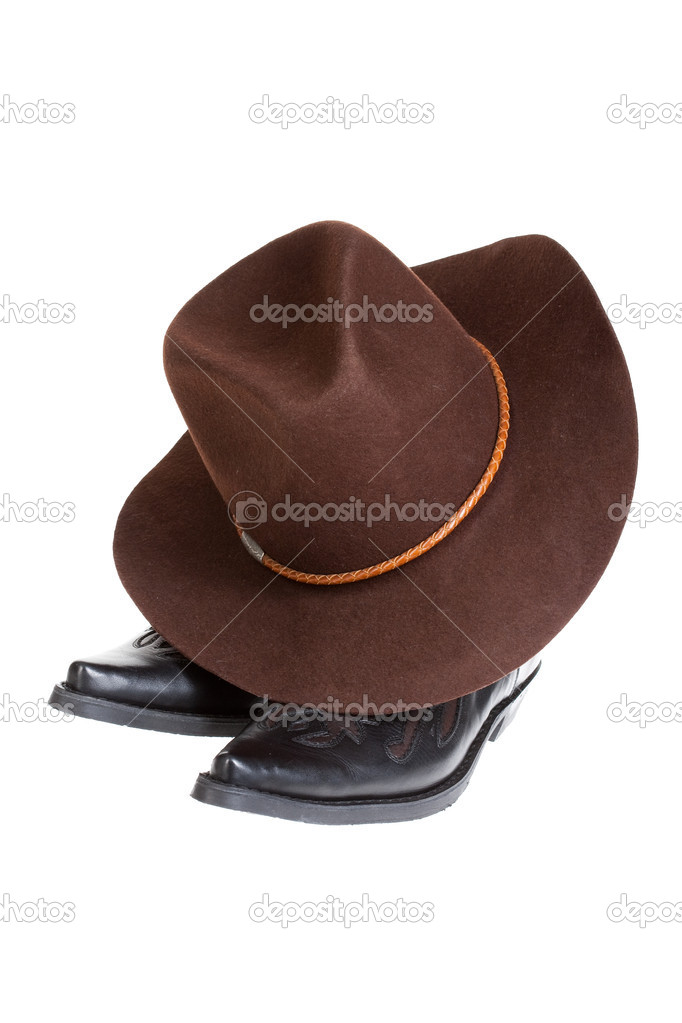 Cowboy hat and boots on isolated background — Stock Photo #2642927