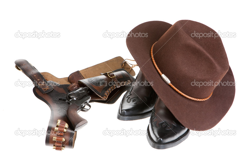 Cowboy Hat And Boots Background Cowboy Hat Boots Revolver And Holster on Isolated Background Photo by