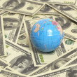 Royalty-Free Stock Photo: Globe on US hundred dollar bills