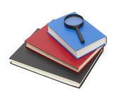 Pila de libros y la lupa — Foto de Stock