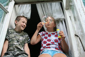 Kids and soap-bubble — Stock Photo