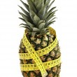 Pineapple with measuring tape. — Stock Photo #2391679