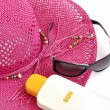 Royalty-Free Stock Photo: Hat, bottle of balm solar and glasses.