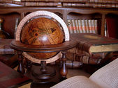 Ancient books and globe. — Stock Photo
