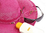 Hat, bottle of balm solar and glasses. — Stock Photo