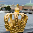 Royalty-Free Stock Photo: Golden crown on the bridge
