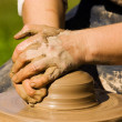 Stock Photo: Potters hands