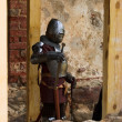 Armoured knight with swords — Stock Photo
