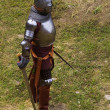 Stock Photo: Armoured knight with swords