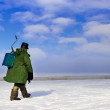 Stock Photo: Ice Fisherman going away