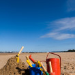 Beach toys in the sandy beach -  