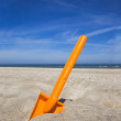 Orange plastic beache spade — Stock Photo