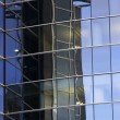 Reflections of office skyscraper — Stock Photo