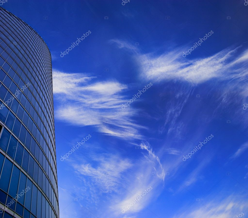 Office skyscraper facade on deep blue sky with white clouds. Place for copy space. — Stock Photo #2511597