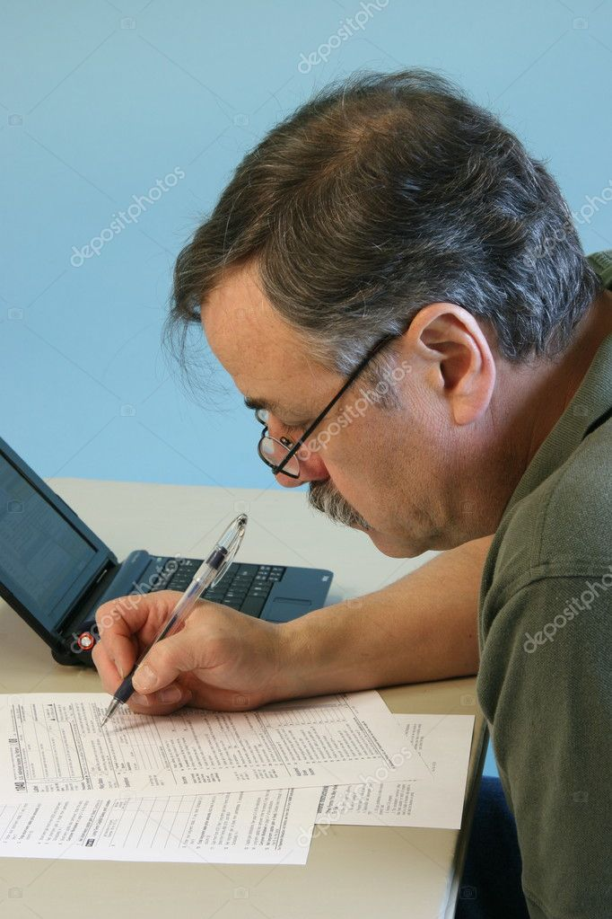 Man Filling in 1040 Federal Income Tax Form  Stock Photo #2457436