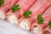 Ham rolls filled by whipped cream — Stock Photo