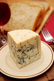 Fresh blue cheese with decoration — Stock Photo