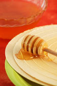 Waffle and honey dipper — Stock Photo