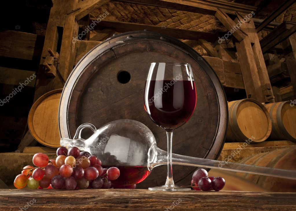 Still life with red wine and old barrels — Stock Photo #2408147
