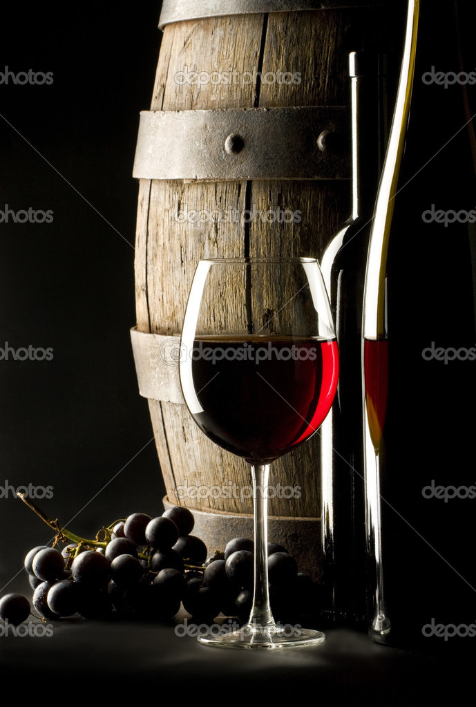Still life with glass of red wine, two bottles and old barrel   #2448778
