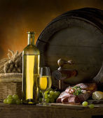 Still-life with wine and barrels — Stock Photo
