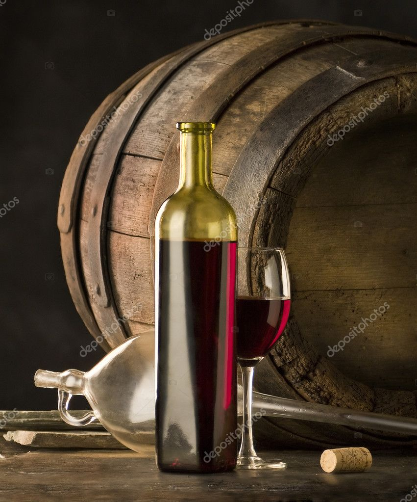 The bottle of red wine and glass and wine-cask — Stock Photo #2454774