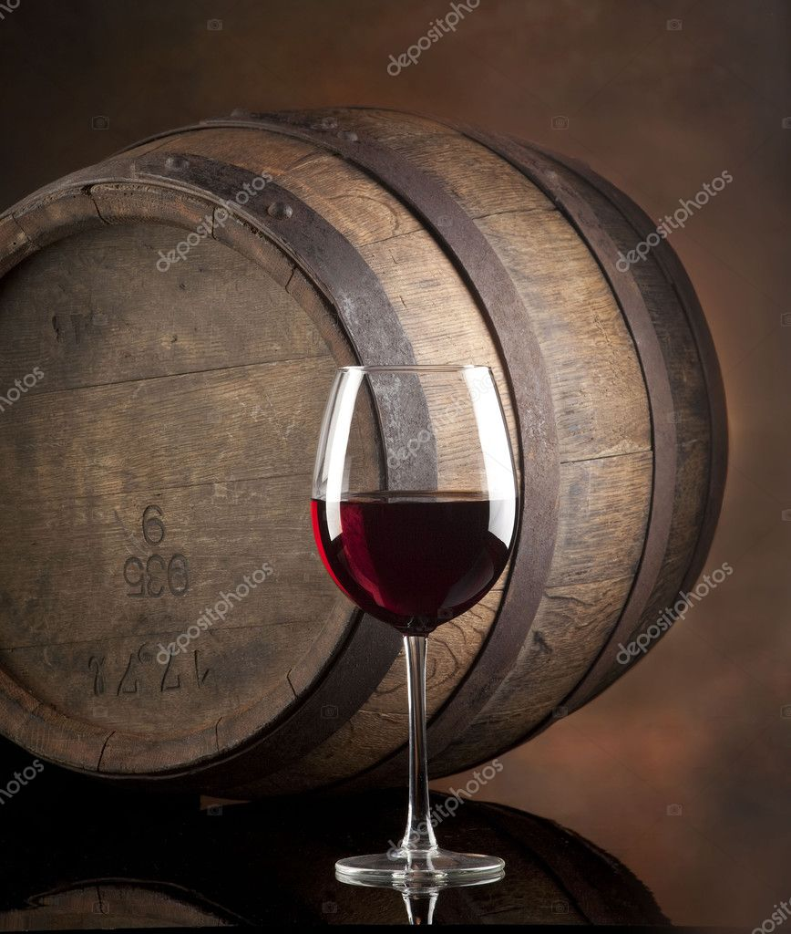 Glass of  red wine with barrel — Stock Photo #2454798