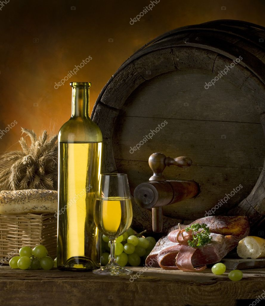 Still life with white wine, old barrel, ham and bread — Stock Photo #2454824