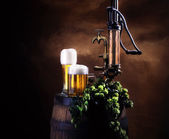 Still-life with beer and barrel — Stock Photo