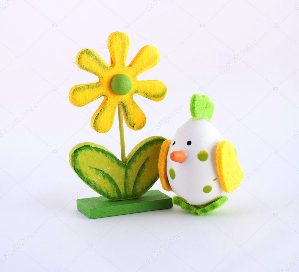  Easter simbol yellow wooden flower and white egg as chicken toy  Stock Photo #2515807