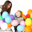 Mother and son playing party balloons — Stock Photo