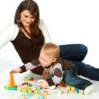 Mother and son playing wooden cubes — Stock Photo #2540296