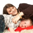 Stock Photo: Smiling mother lying with her son