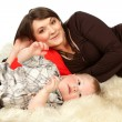 Smiling mother lying with her son — Stock Photo #2540340